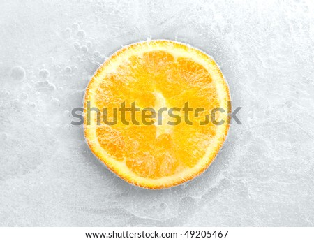 stock-photo-orange-frozen-in-ice-49205467.jpg