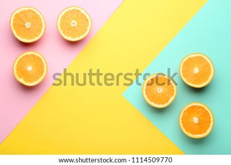 Orange fruit on colorful background #1114509770
