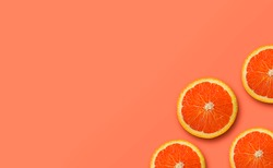 orange fruit on yellow and peach color background