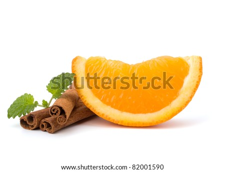 Orange fruit segment, cinnamon sticks and mint isolated on white background. Hot drinks ingredients.