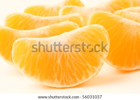 Orange fruit. Slices peeled tangerine. Mandarin section segment on white background