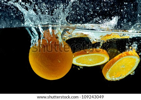 Orange Fruit splash on water. Various fresh and healthy fruit picture taken as they dramatically submerged into a clean water.