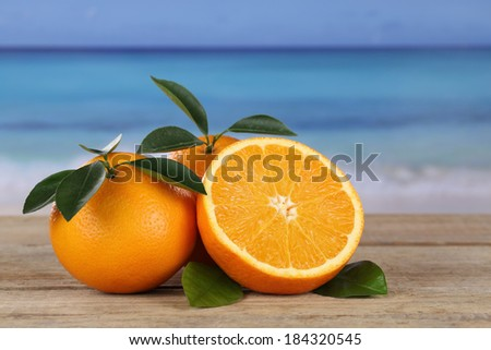 Orange fruits on the beach while on vacation