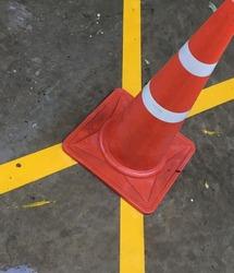 Orange funnel caution sign.