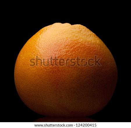 orange grapefruit on a black background