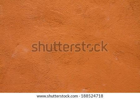 Orange grunge cement wall, textured background