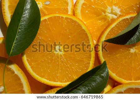 Orange, half of orange, orange lobule and basket with oranges on the wooden table on the wood background #646719865