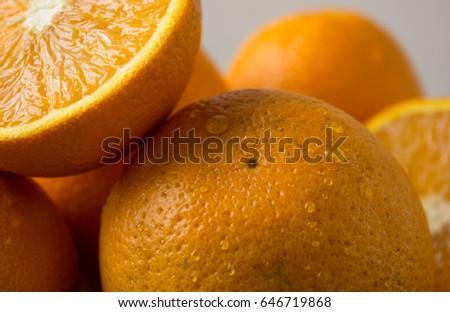 Orange, half of orange, orange lobule and basket with oranges on the wooden table on the wood background #646719868