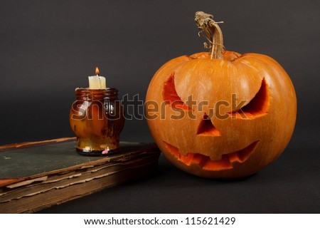 Orange halloween pumpkin on dark blue background