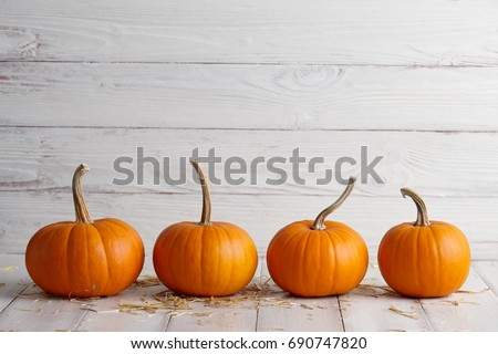 Orange halloween pumpkins on white planks, holiday decoration #690747820