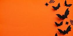 Orange happy halloween banner. Happy Halloween Background vector illustration. Halloween hanging ornaments on orange background.