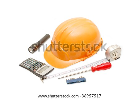 Orange helmet and the tool isolated on white background - stock photo