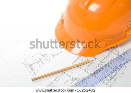 orange helmet, pencil, ruler and blueprint, building engineering concept, horizontal orientation
