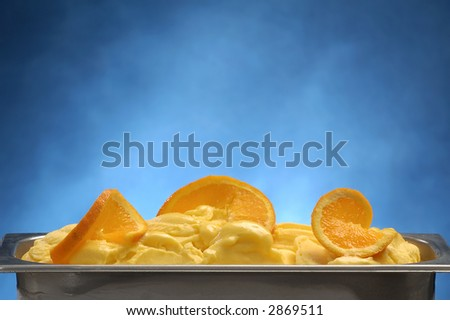 Orange ice cream on a blue background
