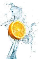 orange is dropped into water splash on white