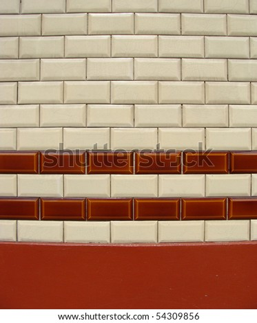 orange ivory white tile pattern on a wall