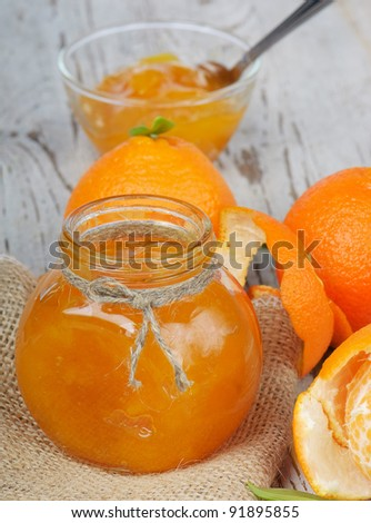 Orange jam on a wooden table