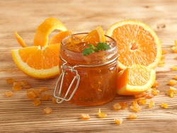 orange jam on wooden background