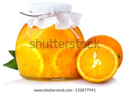 Orange jam with ripe fruits isolated on white - stock photo