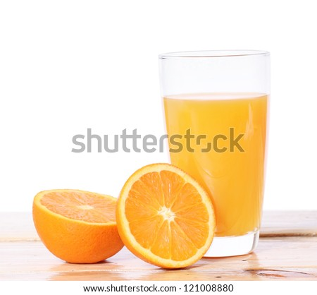 Orange juice and slices on wood