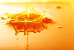 Orange juice background / Orange juice is the liquid extract of the orange tree fruit produced by squeezing oranges.
