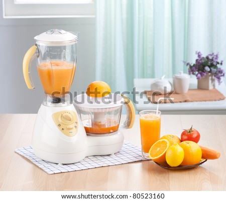 Orange juice blender machine in the kitchen interior