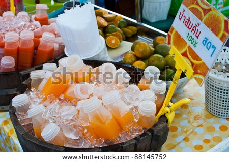 orange juice bottles in ice basket