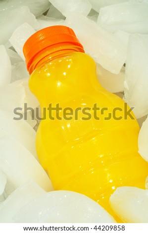 Orange Juice in a Bottle on Ice