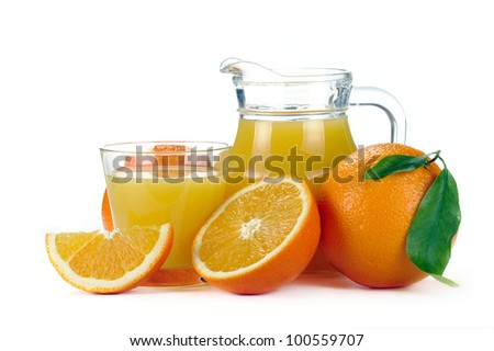 orange juice in a jug and a glass of fruit