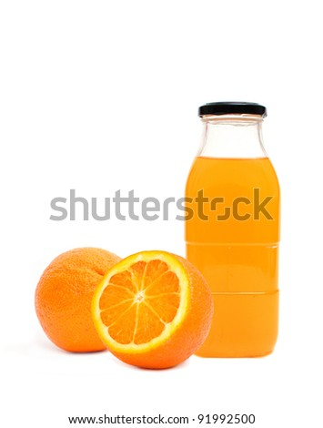 Orange juice in glass bottle over a white background