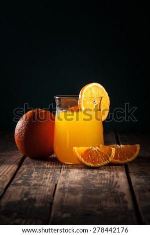 Orange juice in glass on black background/Orange juice in glass