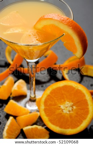 Orange juice served in a cocktail glass