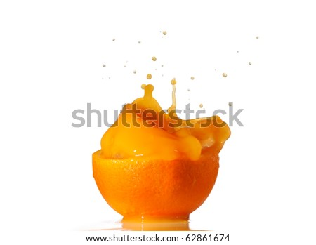 Orange juice splash inside an half orange isolated on white
