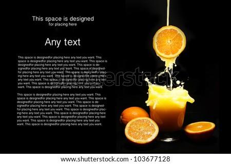 Orange juice splash on black background