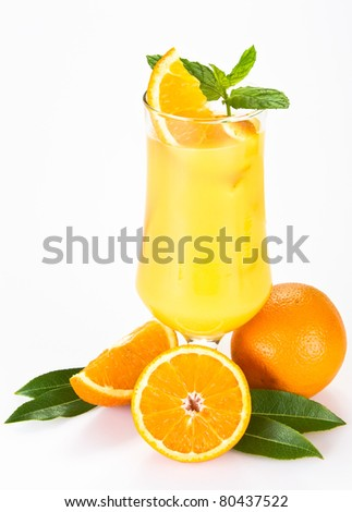 Orange juice with the pieces of orange in the glass - isolated