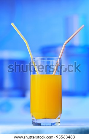 orange juice with two straw