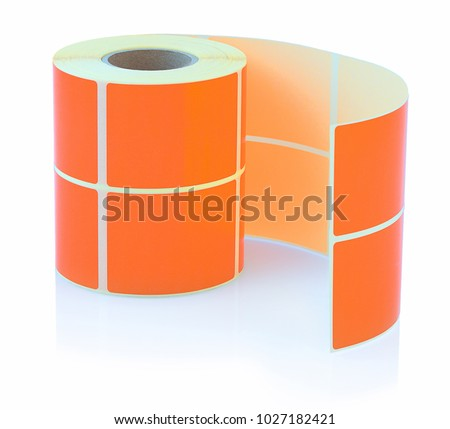 Orange label roll isolated on white background with shadow reflection. Color reel of labels for printers. Labels for direct thermal or thermal transfer printing. #1027182421