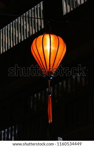 Orange lanterne with black background, Hoi An, Vietnam,  February 2013 #1160534449