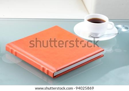 orange leather book on bright background