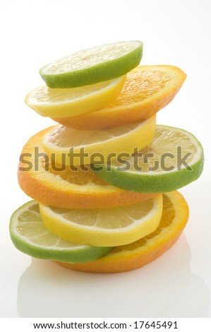 Orange, lemon and lime slices in a stack on a white background