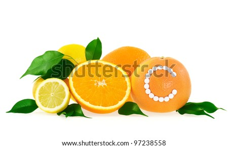 Orange, lemon, grapefruit with vitamin c pills over white background - citrus fruits concept