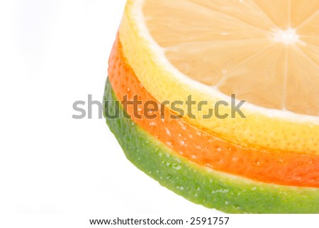 Orange, lemon, lime slices on white