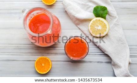 Orange lemonade and strawberries.Vegan food.Raw food