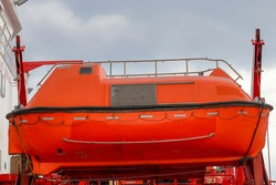 Orange lifeboat aboard the ship