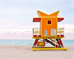 Orange lifeguard tower, art deco Miami Beach life guard stand on South Beach at sunrise