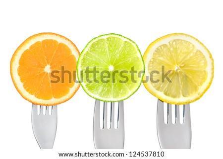 orange lime and lemon slices on forks isolated against white background