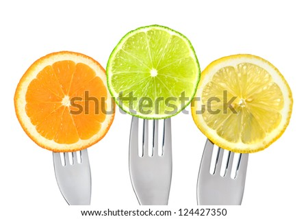 orange lime lemon slices on forks isolated