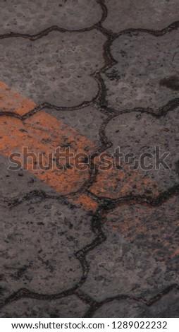 Orange line on the asphalt background