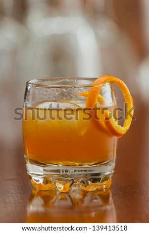 orange liquor served on the rocks with an orange twist as a garnish