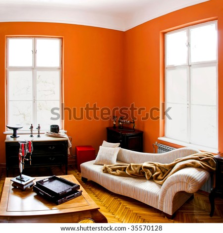 Orange living room with vintage style furniture